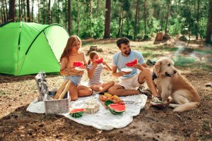 Camping family with child dog